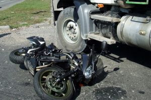 Tractor trailer truck blows throw stop sign resulting in motorcyclists death